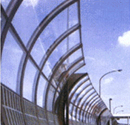 Polycarbonate applied highway noise barrier